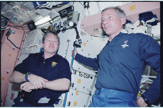 STS098-355-012 - STS-098 - Shepherd and Cockrell in Node 1