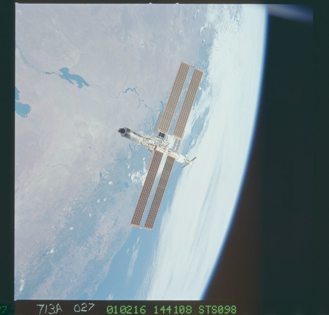 STS098-713A-027 - STS-098 - Zenith view of ISS over Earth limb taken during fly-around