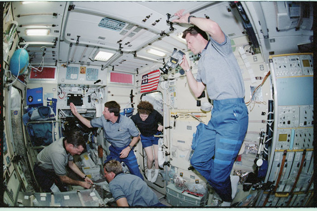 STS100-338-019 - STS-100 - Expedition Two and STS-100 crewmembers gather in Zvezda during STS-100's ingress into the ISS