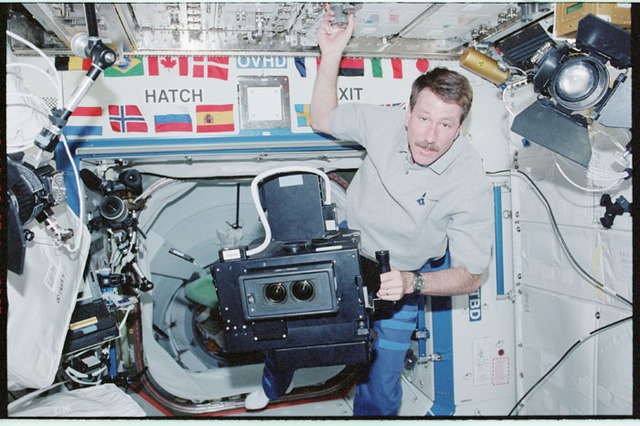 STS100-345-035 - STS-100 - Commander Rominger works with the IMAX camera in Destiny during the STS-100 visit
