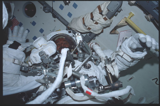 STS100-388-015 - STS-100 - MS Hadfield in his EMU in the airlock of Endeavour during STS-100