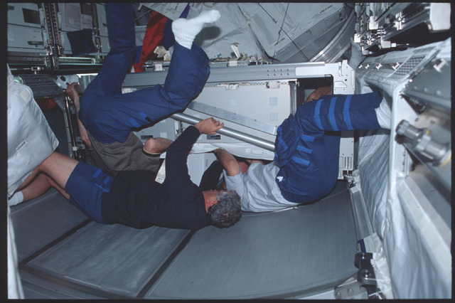STS100-389-026 - STS-100 - Crewmembers work in the Multipurpose Logistics Module (MPLM) during STS-100