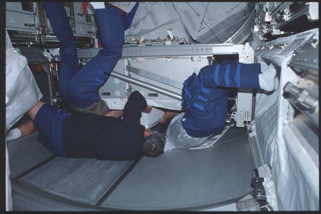 STS100-389-027 - STS-100 - Crewmembers work in the Multipurpose Logistics Module (MPLM) during STS-100