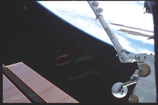 STS100-390-030 - STS-100 - View of the SSRMS and Spacelab Pallet taken during STS-100