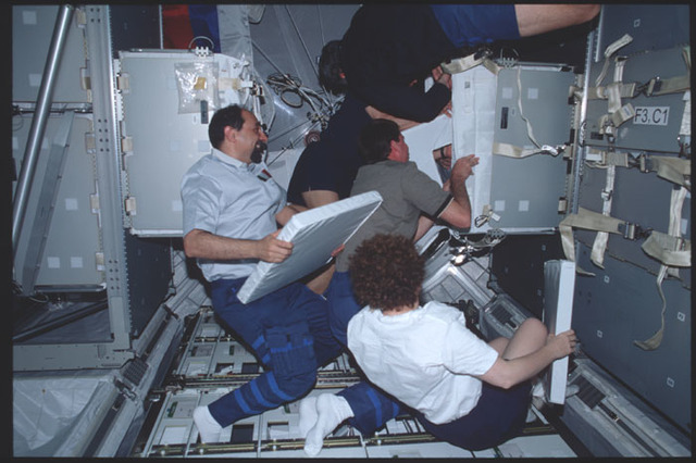 STS100-391-002 - STS-100 - STS-100 and Expedition Two crews transfer equipment from the MPLM during STS-100
