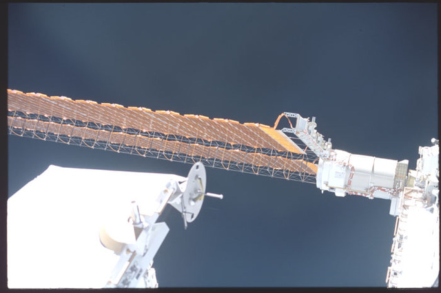 STS100-393-005 - STS-100 - View of Spacelab Pallet, P6 Truss Mast Canister and Solar Array Wing taken during STS-100