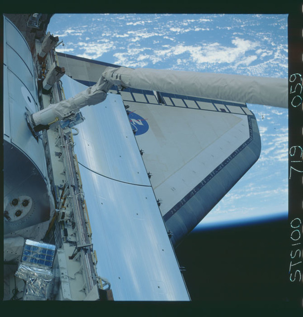 STS100-719-059 - STS-100 - View of the MPLM grappled by the RMS in Endeavour's payload bay taken during STS-100.