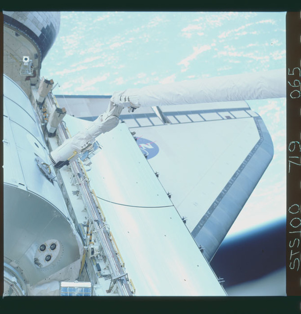 STS100-719-065 - STS-100 - View of the MPLM grappled by the RMS in Endeavour's payload bay taken during STS-100.
