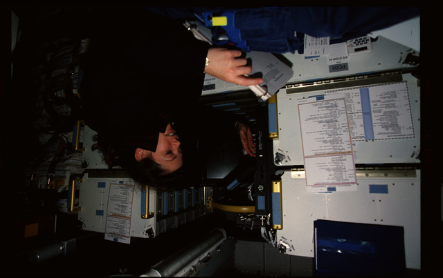 STS101-357-013 - STS-101 - MS Weber enters data into a PGSC in Spacehab