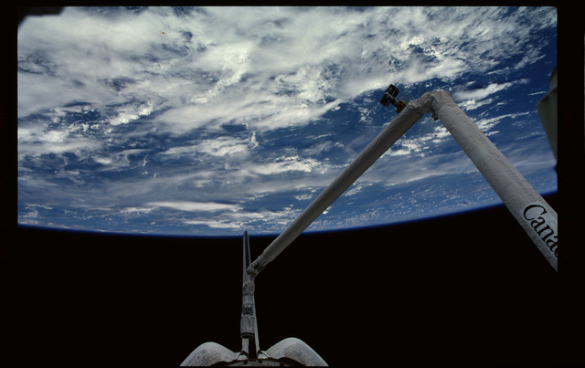 STS101-367-034 - STS-101 - RMS arm extended with Earth limb in the background