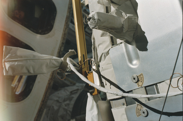 STS101-373-016 - STS-101 - Cables,handrails and trunnion pin cover on Node 1