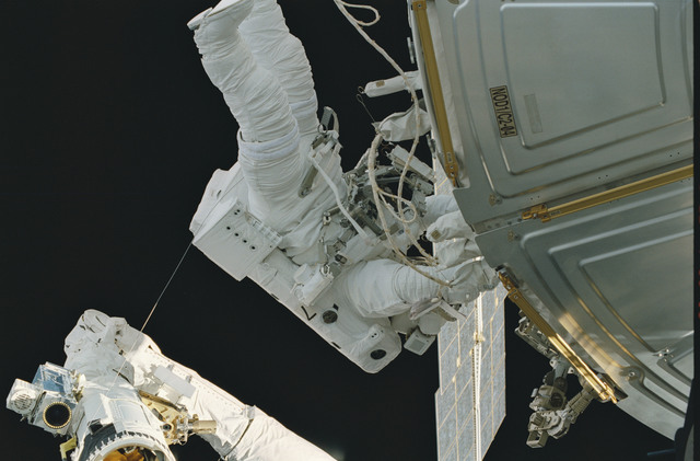 STS101-373-022 - STS-101 - MS Voss on RMS arm during extravehicular activity (EVA)
