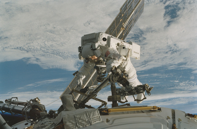 STS101-373-024 - STS-101 - MS Voss on RMS arm during extravehicular activity (EVA)
