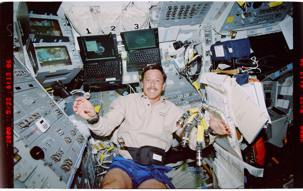 STS101-383-002 - STS-101 - PLT Horowitz on flight deck with EMU hardware