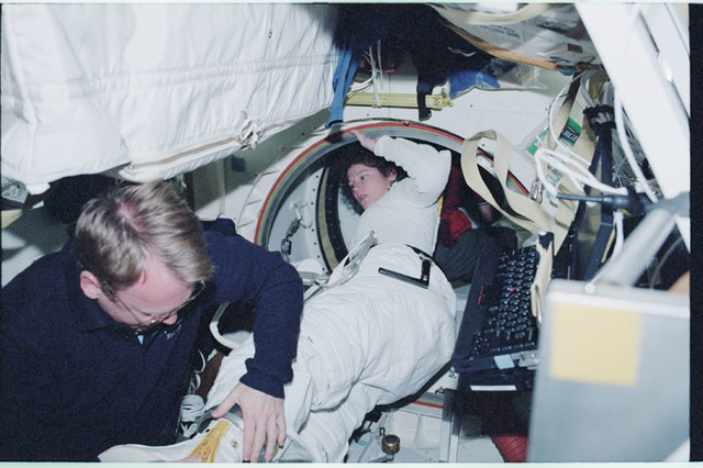 STS102-323-022 - STS-102 - Helms suits up for an EVA