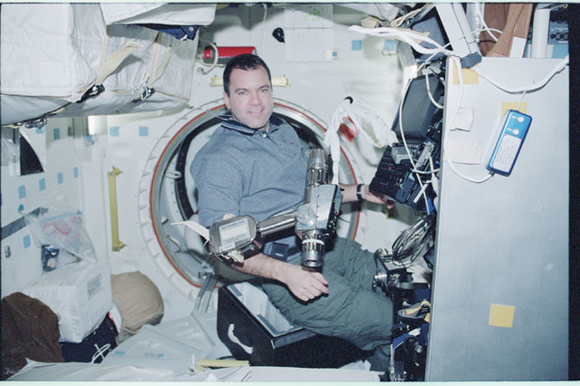 STS102-346-027 - STS-102 - Richards with PGT in the orbiter middeck