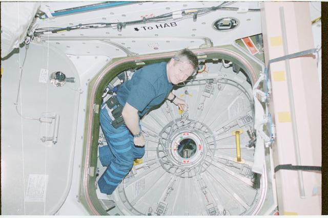 STS102-368-001 - STS-102 - Shepherd prepares to open hatch into MPLM/Leonardo module;
