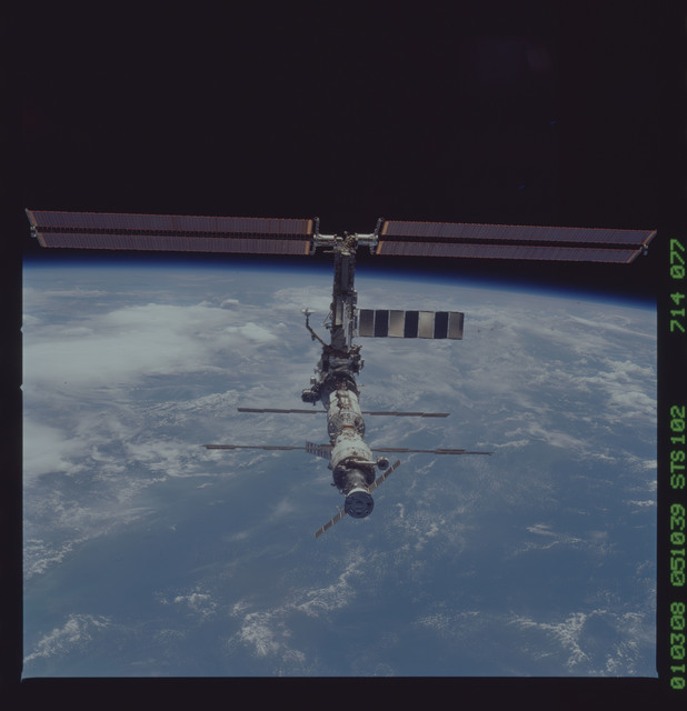 STS102-714-077 - STS-102 - Fly-around views of ISS
