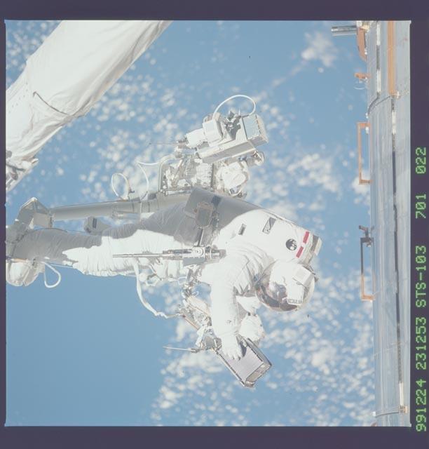STS103-701-022 - STS-103 - 3rd EVA - ESTR-3 removal/SSR-3 installation