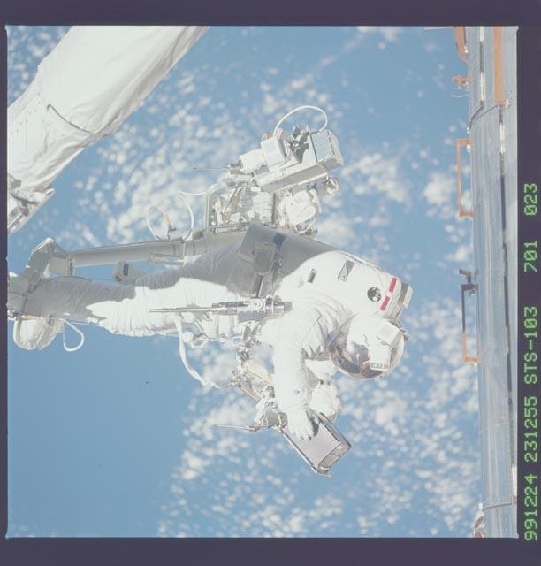 STS103-701-023 - STS-103 - 3rd EVA - ESTR-3 removal/SSR-3 installation