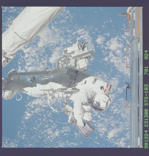STS103-701-024 - STS-103 - 3rd EVA - ESTR-3 removal/SSR-3 installation