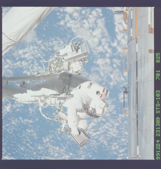 STS103-701-025 - STS-103 - 3rd EVA - ESTR-3 removal/SSR-3 installation