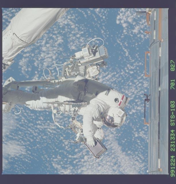 STS103-701-027 - STS-103 - 3rd EVA - ESTR-3 removal/SSR-3 installation