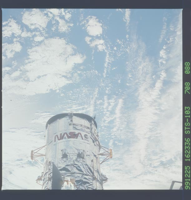 STS103-708-088 - STS-103 - View of the HST after the 3rd EVA