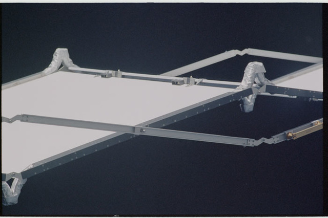 STS104-317-027 - STS-104 - P6 Truss, S-Band Antenna Subassembly (SASA), Mast Canister and PV Radiator