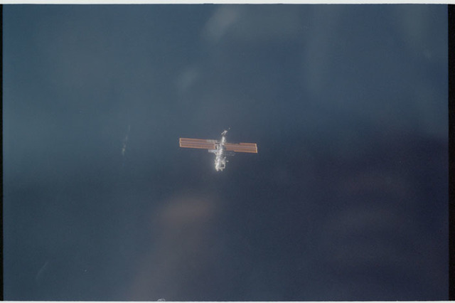 STS104-320-016 - STS-104 - Distant forward view of ISS after undocking