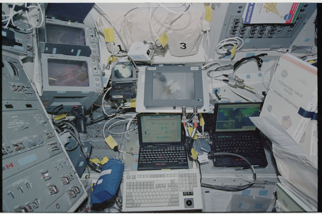 STS104-326-003 - STS-104 - Laptop computer and CCTV screens on orbiter Atlantis aft flight deck