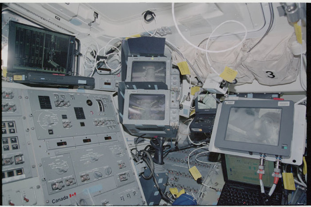 STS104-326-006 - STS-104 - Laptop computer and CCTV screens on orbiter Atlantis aft flight deck