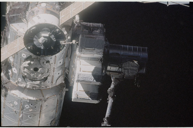 STS104-332-016 - STS-104 - Dark view of  Quest airlock on Destiny lab and Soyuz TM seen during flyaround