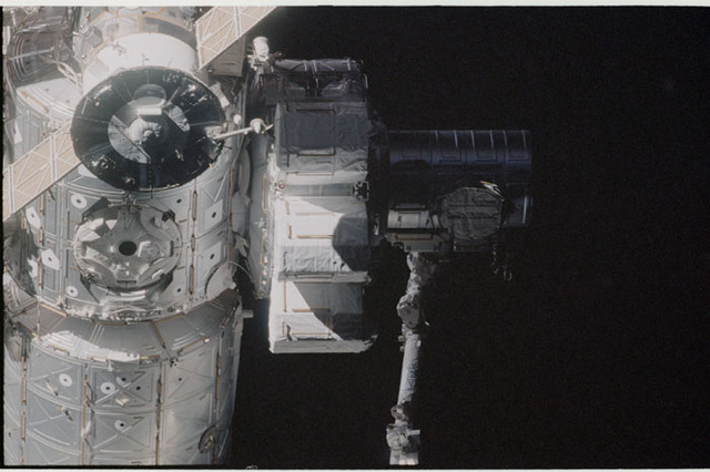 STS104-332-017 - STS-104 - Dark view of  Quest airlock on Destiny lab and Soyuz TM seen during flyaround