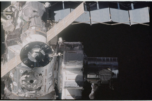STS104-332-018 - STS-104 - Dark view of  Quest airlock on Destiny lab and Soyuz TM seen during flyaround
