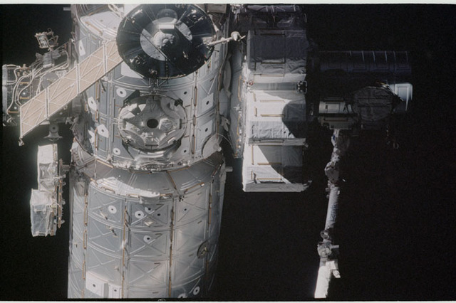 STS104-332-019 - STS-104 - Dark view of  Quest airlock on Destiny lab and Soyuz TM seen during flyaround
