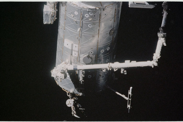STS104-332-020 - STS-104 - Dark view of  Canadarm2 on Destiny lab  seen during flyaround