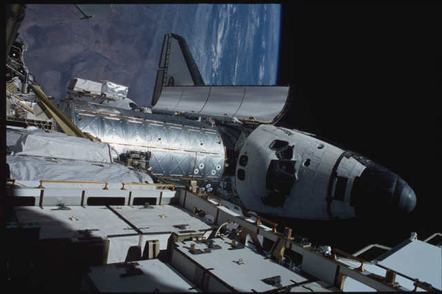 STS104-358-006 - STS-104 - View of orbiter Atlantis and Destiny lab from P6 truss during EVA 3