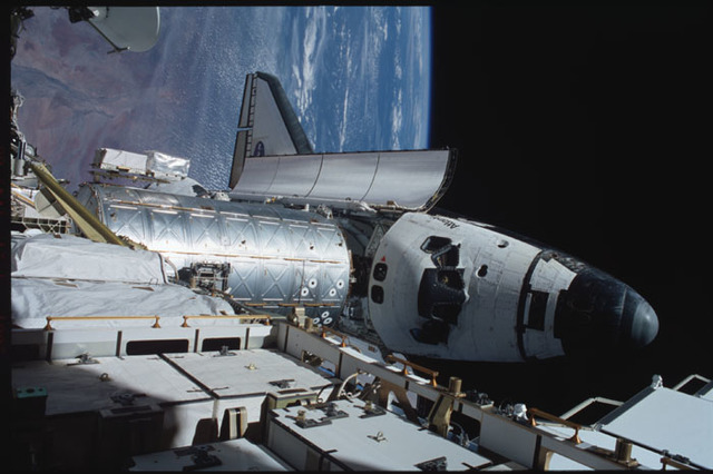 STS104-358-010 - STS-104 - View of orbiter Atlantis and Destiny lab from P6 truss during EVA 3