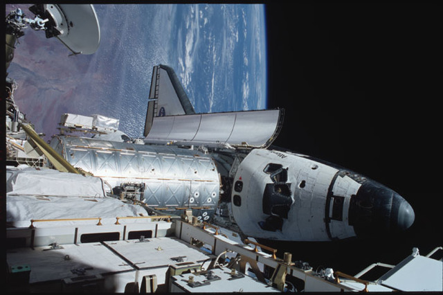 STS104-358-011 - STS-104 - View of orbiter Atlantis and Destiny lab from P6 truss during EVA 3