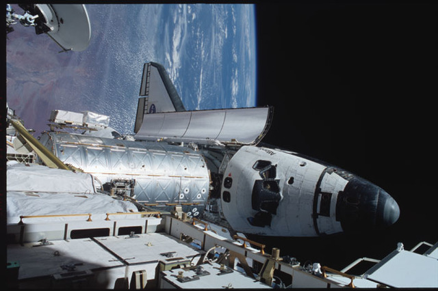STS104-358-012 - STS-104 - View of orbiter Atlantis and Destiny lab from P6 truss during EVA 3