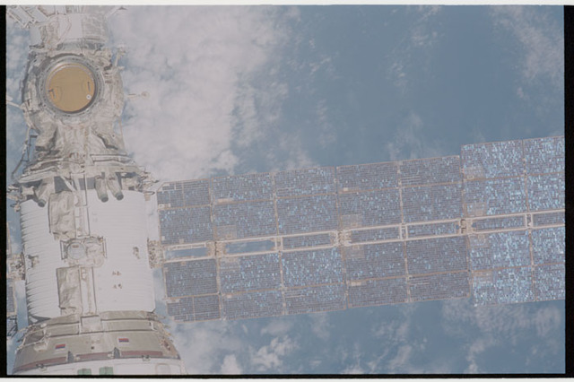 STS105-330-021 - STS-105 - Exterior view of ISS during flyaround by STS-105 showing Service Module and Solar Array