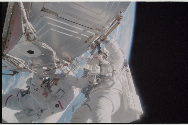 STS105-345-012 - STS-105 - Forrester working with S0 cables on the LAB during EVA2