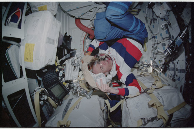 STS105-347-006 - STS-105 - Barry smiles with his EMU helmet on his head