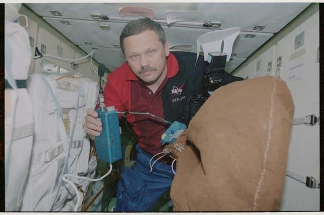 STS106-322-023 - STS-106 - MS Morukov among stowage bags in Zarya taken during STS-106