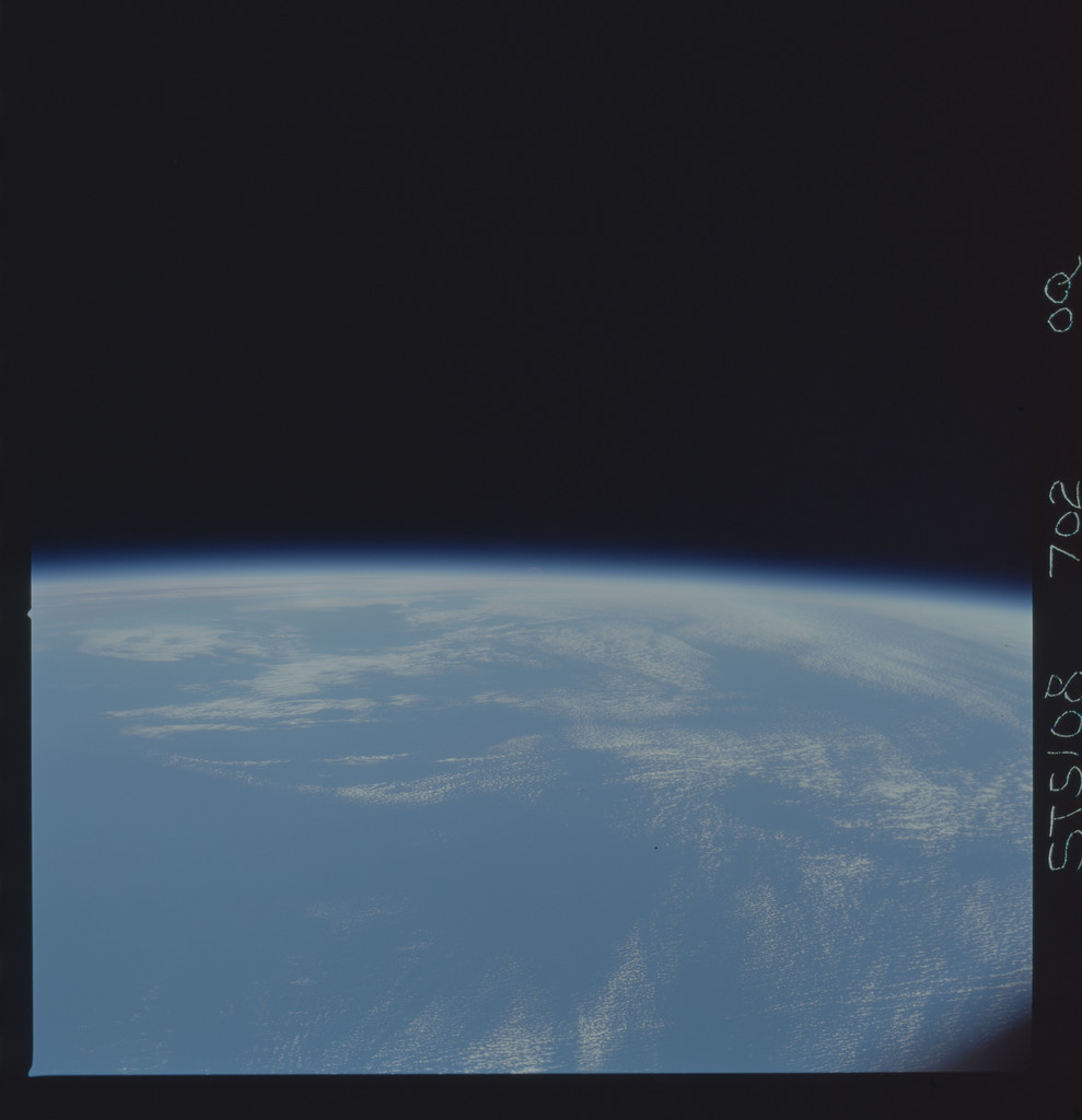 STS108-702-000Q - STS-108 - Earth observations of the Moon over an Earth limb taken during STS-108