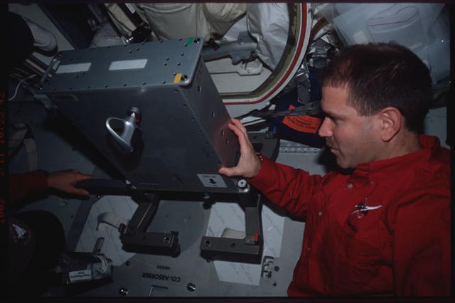 STS109-387-023 - STS-109 - MS Grunsfeld installs ergometer on middeck