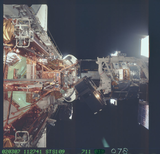 STS109-711-078 - STS-109 - EVA 4 - Replacement of Faint Object Camera