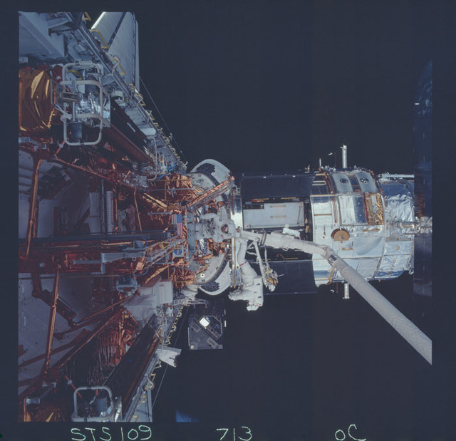 STS109-713-000C - STS-109 - EVA 4 - Removal of the Faint Object Camera
