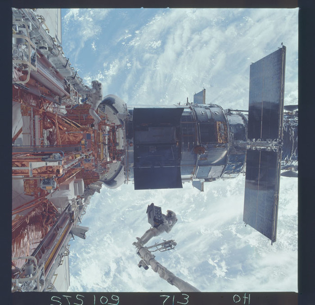 STS109-713-000H - STS-109 - EVA 4 - Installation of the ESM